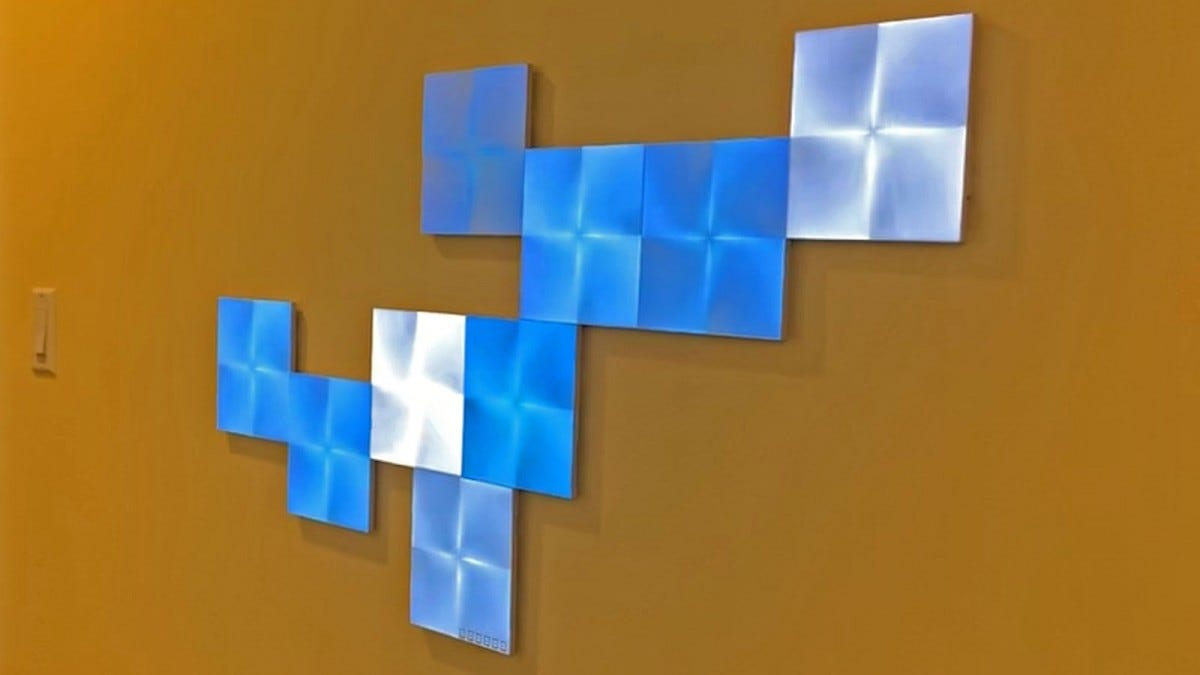 NanoLeaf Canvas panels in shades of blue and white.