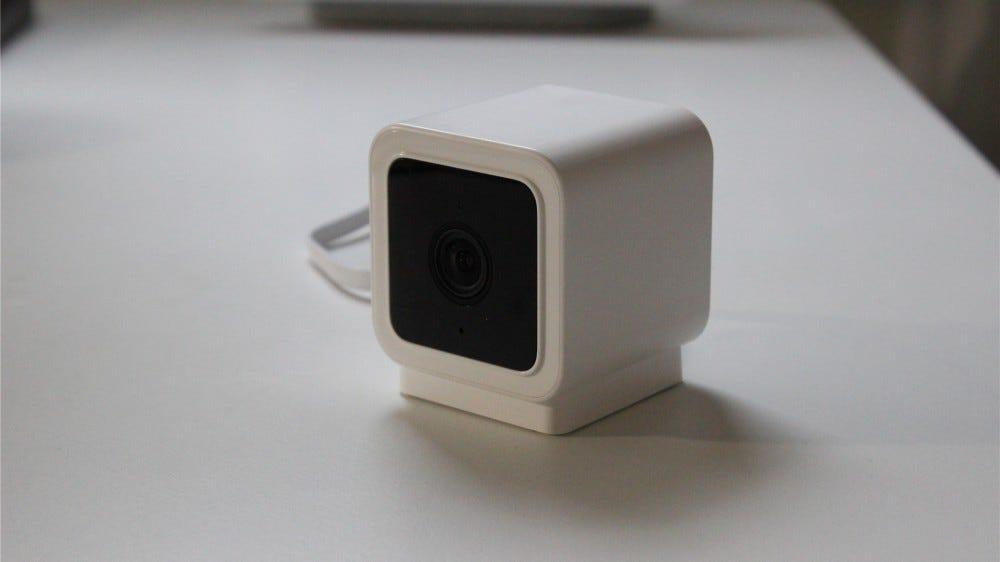 The Wyze Cam v3 on a white desk