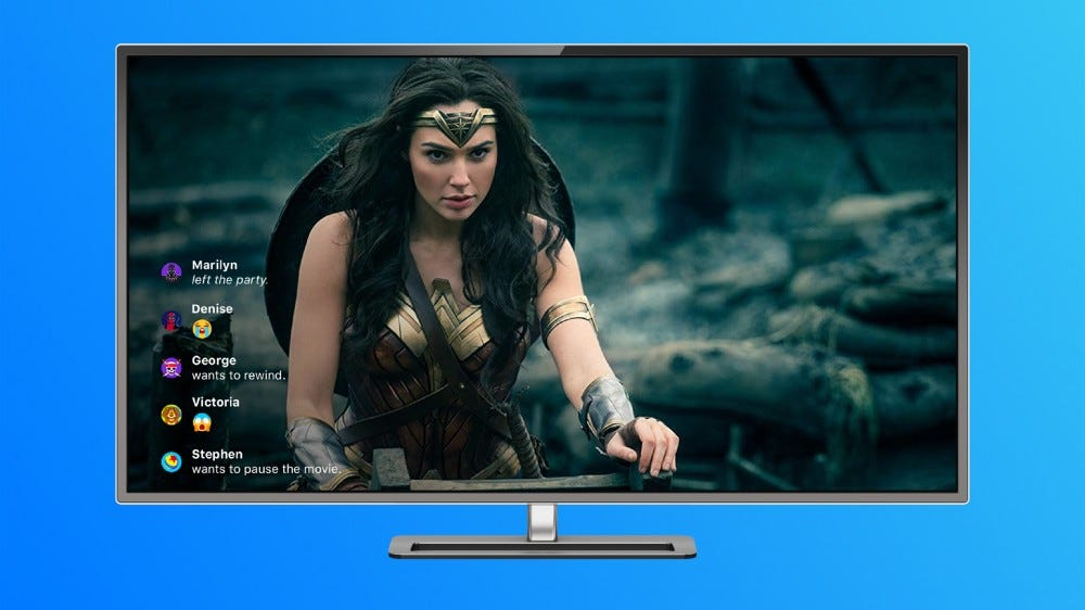 """A TV playing """"Wonder Woman"""" with emoji reactions appearing on the screen."""