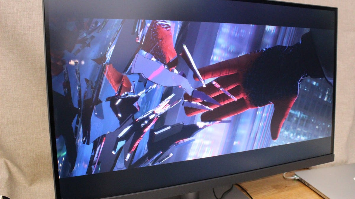 Monitor with Spider-Man: Into the Spider-Verse scene playing.
