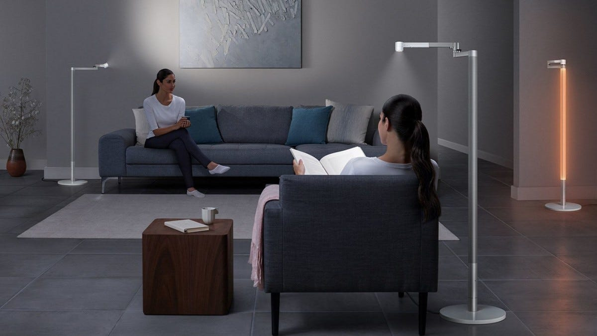 Three Dyson Lightcycle morph lamps in a living room.
