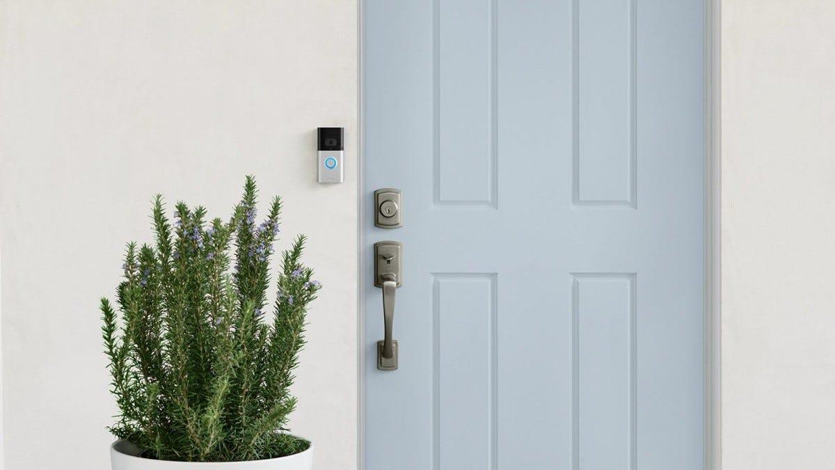 The Ring Video Doorbell 3 next to a blue door