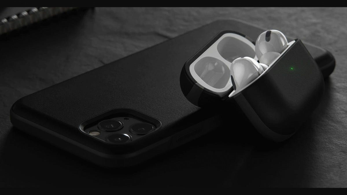 The Nomad AirPods Pro case next to an iPhone 11 Pro case
