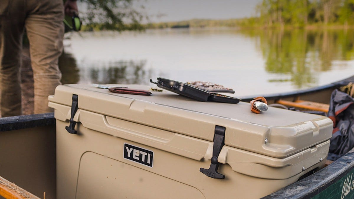 A YETI cooler on a boat with a bunch of boating gear.