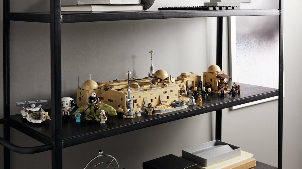A LEGO Mos Eisley Cantina set is displayed on a shelf unit.