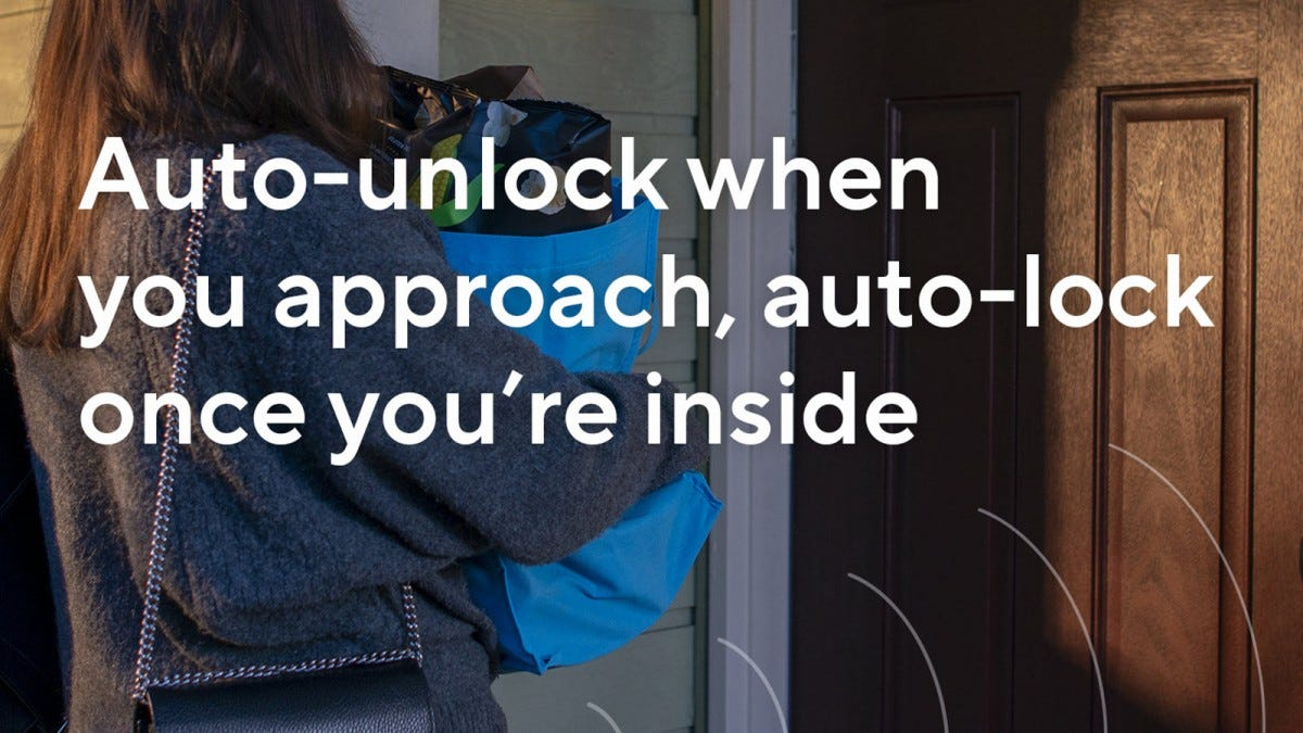 "A woman approaching a door with a bag full of groceries, the words, ""Auto-unlock when you approach, auto-lock once you're inside,"" superimposed."