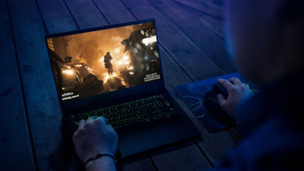 Man Playing Games on Razer Blade Stealth 13