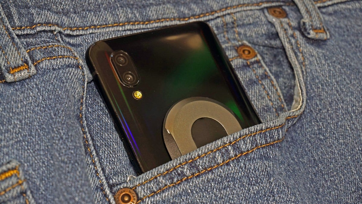 The Ohsnap on a phone, in a blue jeans pocket.