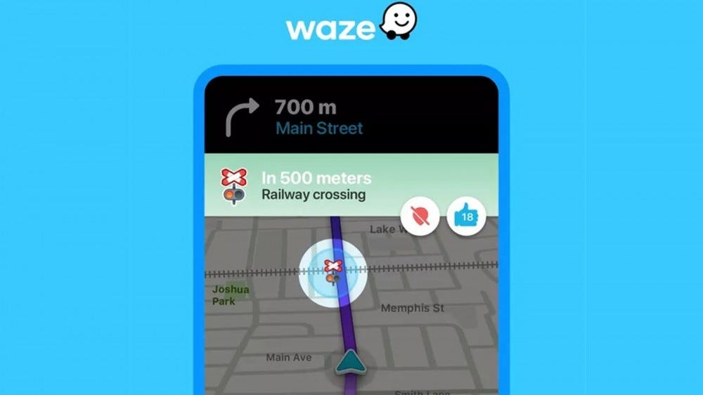 The Waze app notifiying an upcomoing railroad crossing.