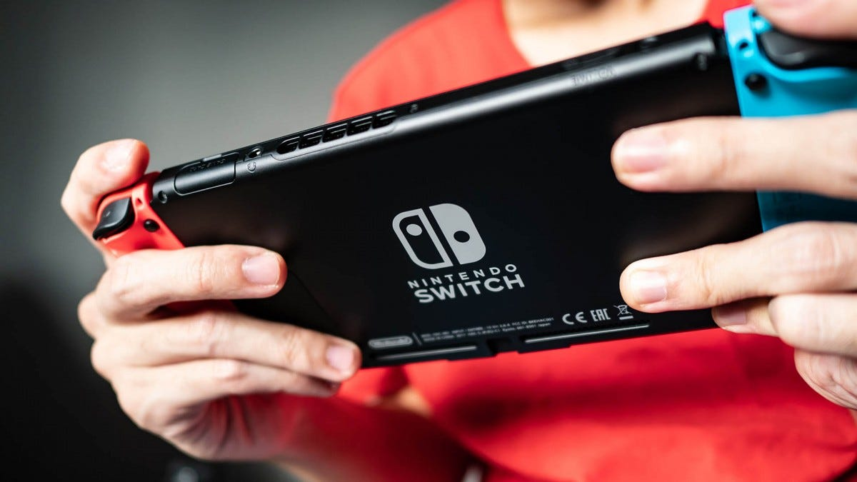 Seated person playing the Nintendo Switch