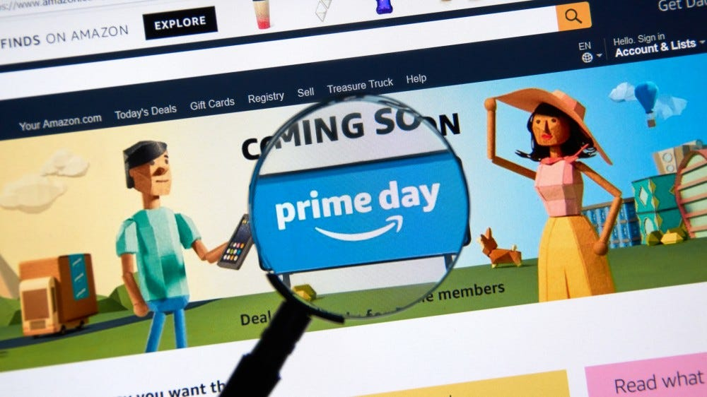 Amazon prime day page on official amazon site under magnifying glass.