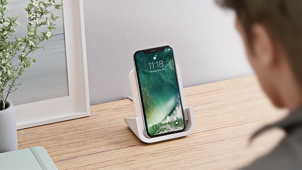 Logitech Powered charging stand with an iPhone unlocking via FaceID