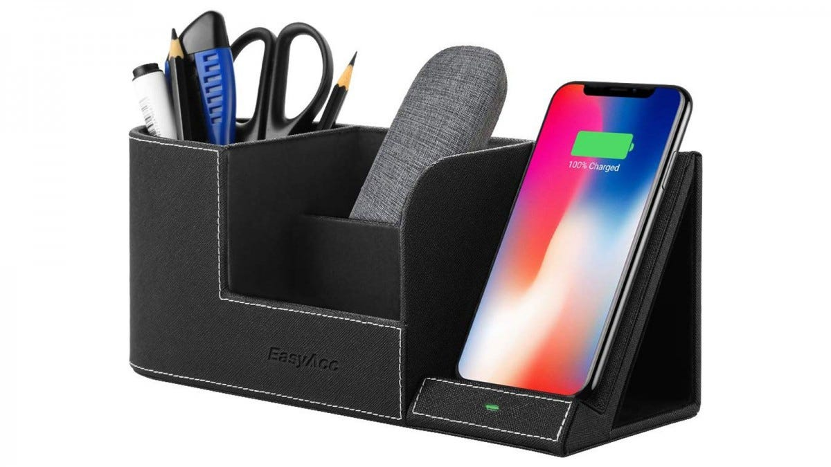 The EasyAcc Wireless Charger with Desk Organizer filled with pencils, pens, a pair of scissors, a glasses case, and smartphone that's charging.