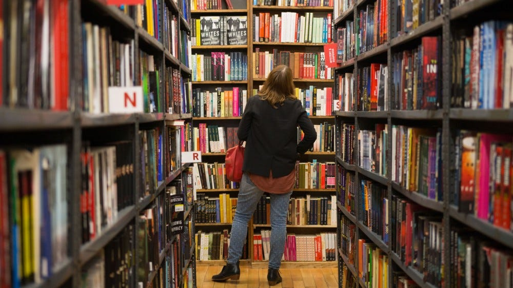 A person looks at books in a New York City bookstore