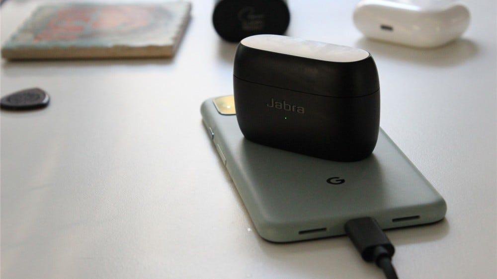 Jabra headphones recharging on top of a Google Pixel 5