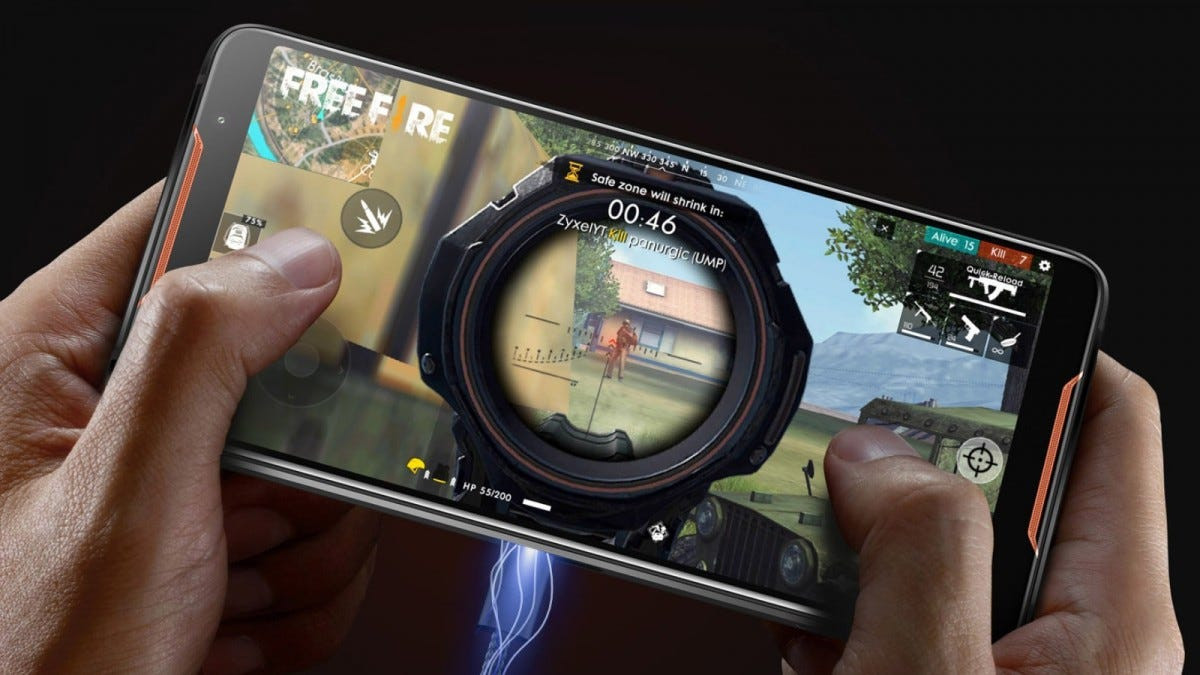 A man's hands playing a game on an Asus phone.