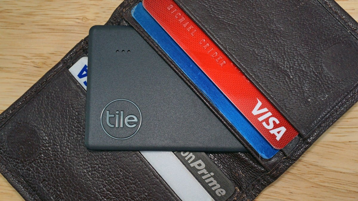 The Tile Slim sliding into a wallet