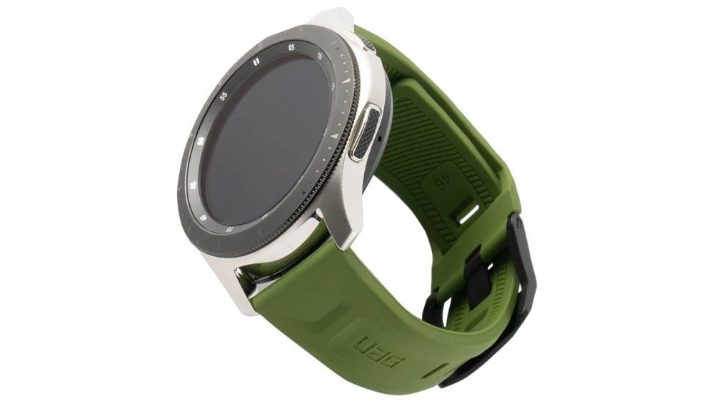 A Galaxy Watch with an Olive colored Scout strap.