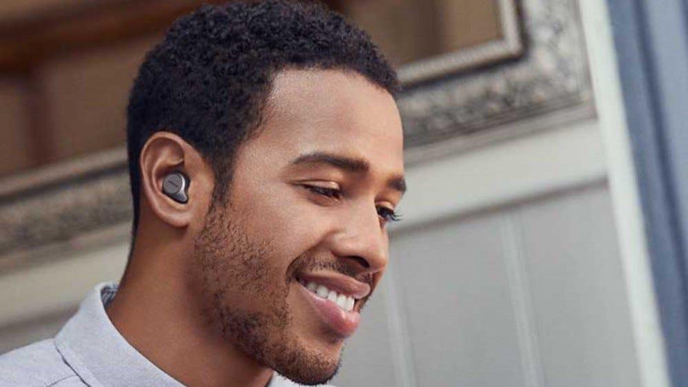 Man listening to Jabra Elite 75t earbuds