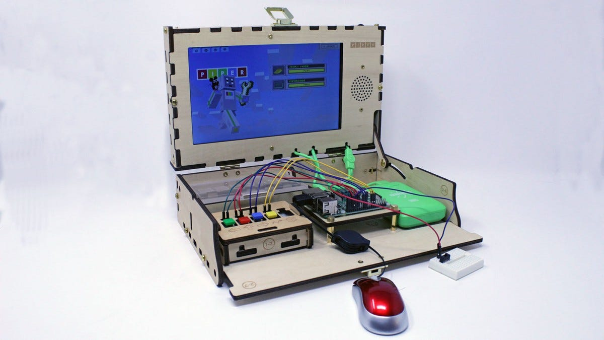 The Piper Computer Kit with red mouse and green battery bank.