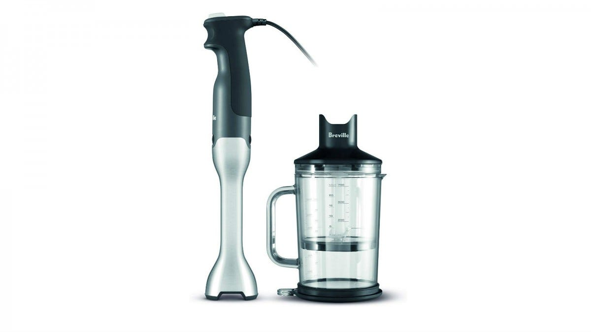 The Breville BSB510XL Control Grip Immersion Blender next to the included chopping bowl.