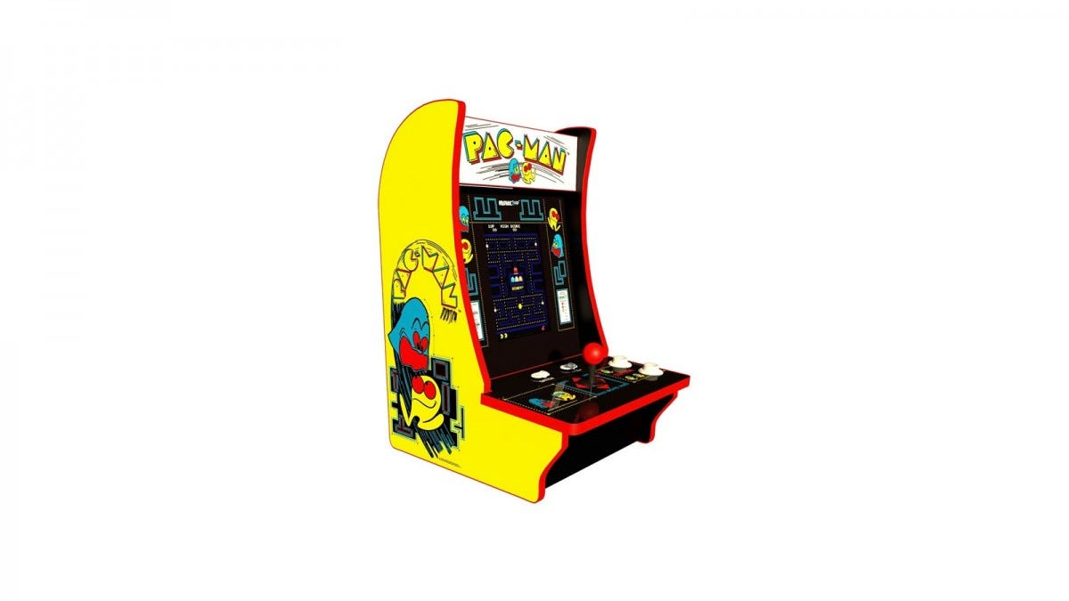A Pac-Man arcade machine with red joystick and yellow siding.