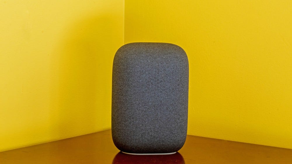 The Nest Audio on a nightstand.