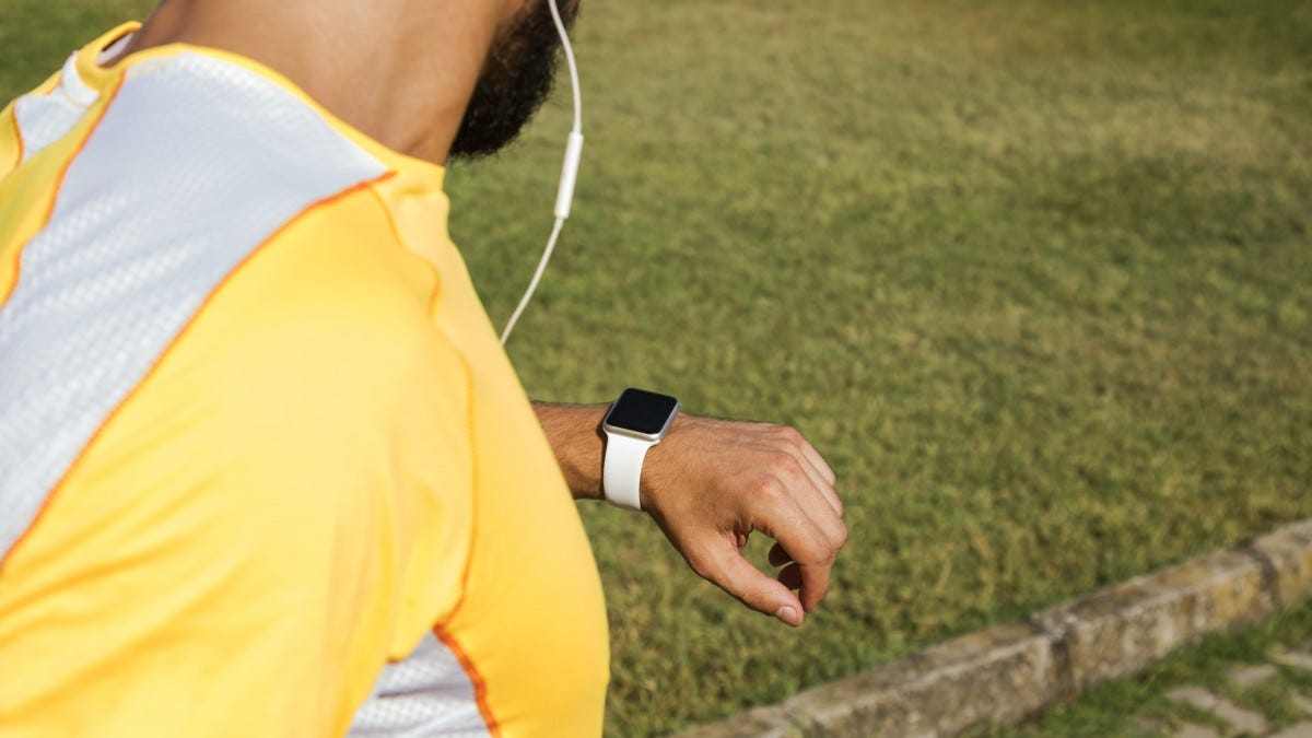 A man running with an Apple Watch and Earpods