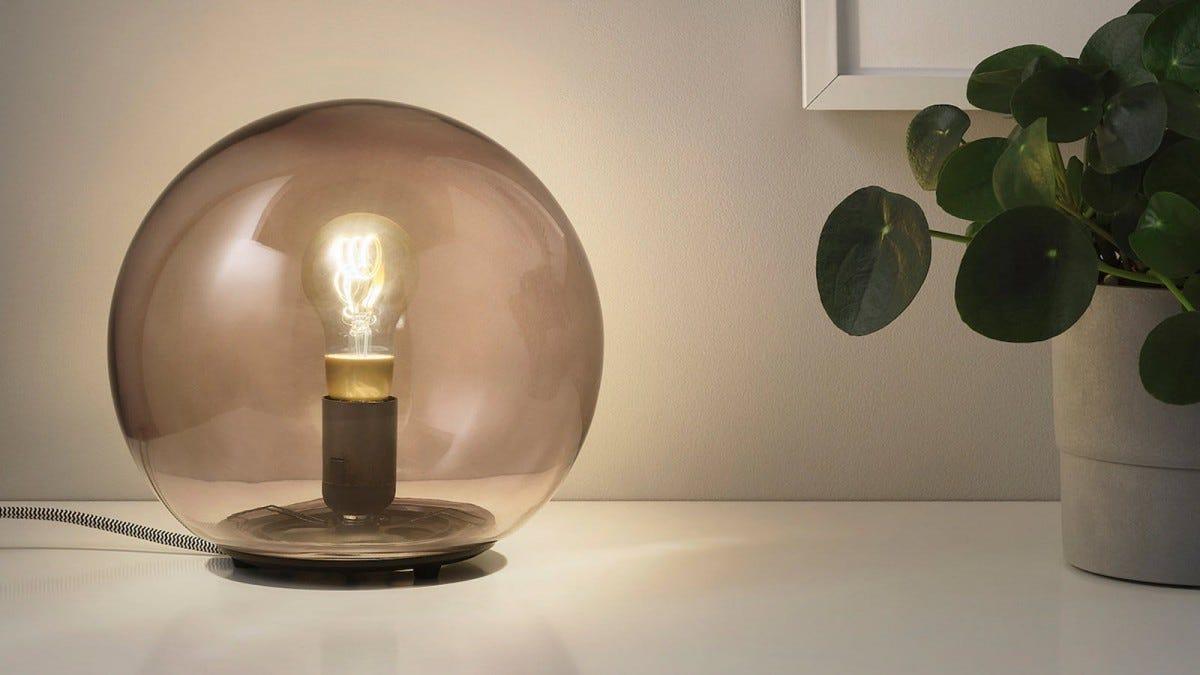 An Edison Style Bulb inside a glass lamp.