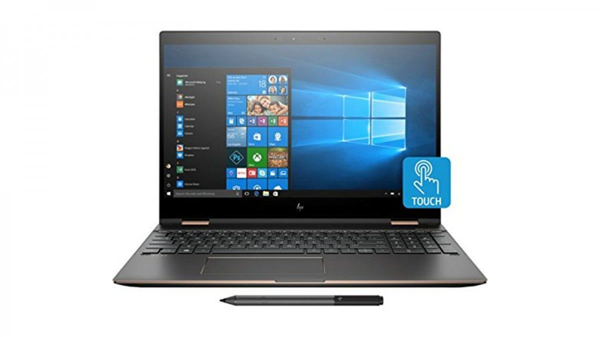 The HP Spectre x360 laptop, showing touch screen controls on the screen.