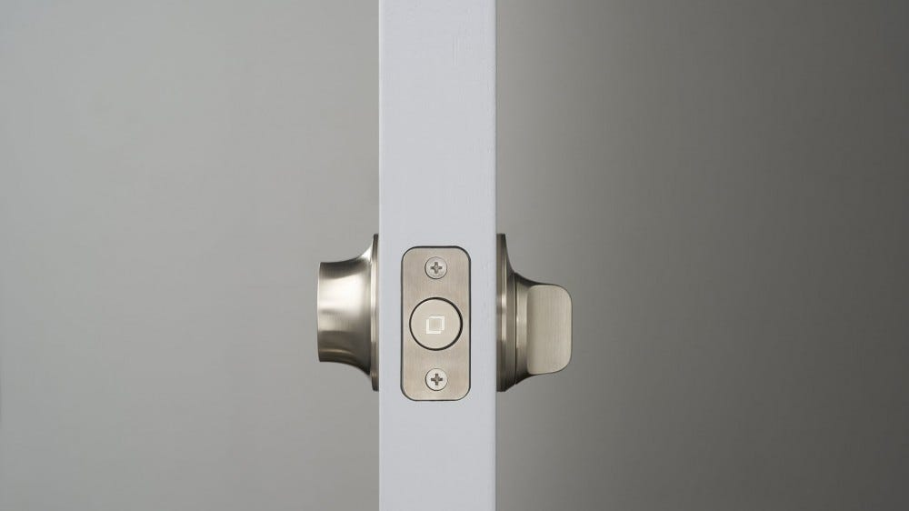 A side view of a smart lock, revealing no visible electronics.