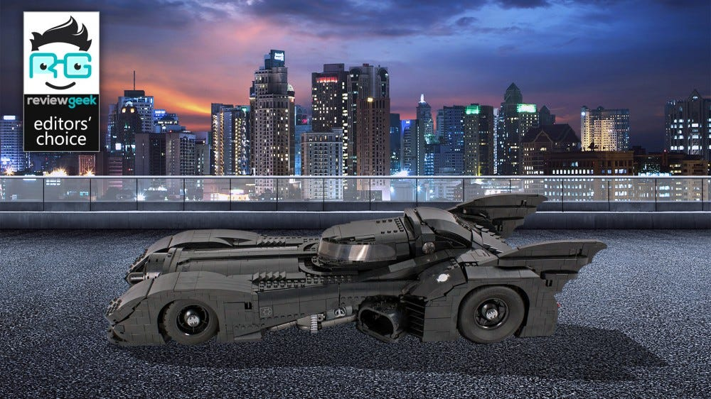 The 1989 LEGO Batmobile in front of a city scape.
