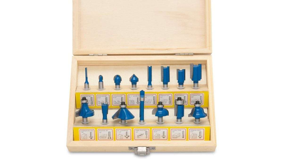 Hiltex 15-piece router bit set in a wooden storage box featuring pictures of the bits.