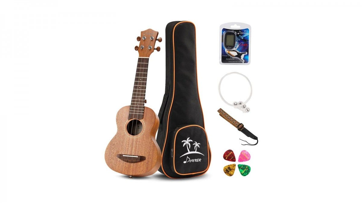 A Donner Soprano Ukulele with case, strap, tuner, and picks.