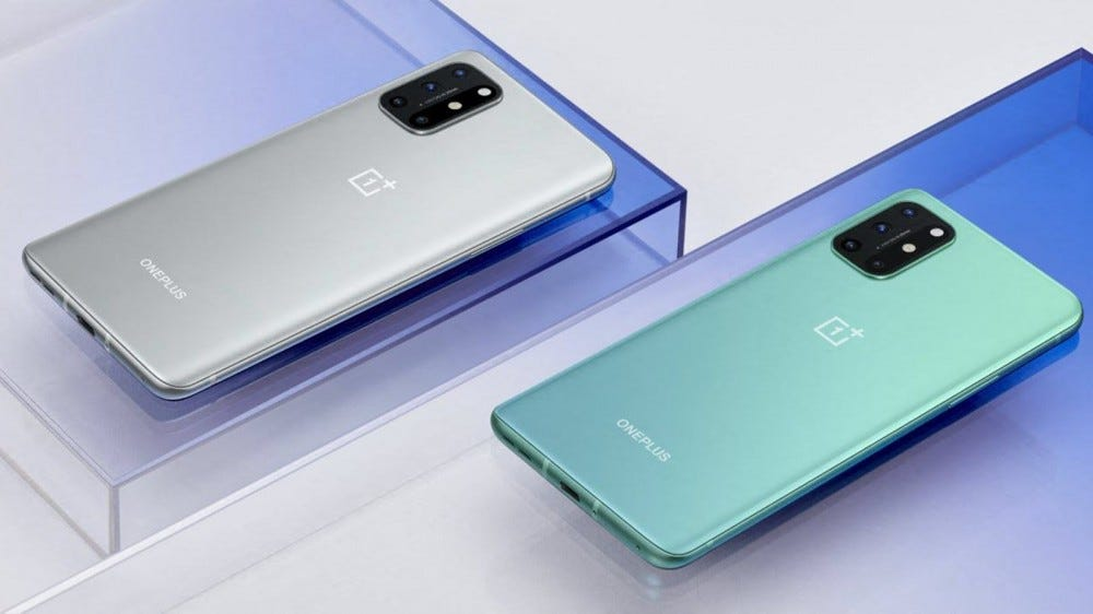 Two OnePlus 8T phones in green and silver.