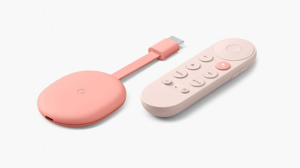 A photo of the pink Chromecast With Google TV dongle and remote.