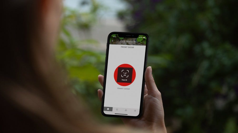 A Yale Smart Lock app with a face scan feature to access remote unlock.