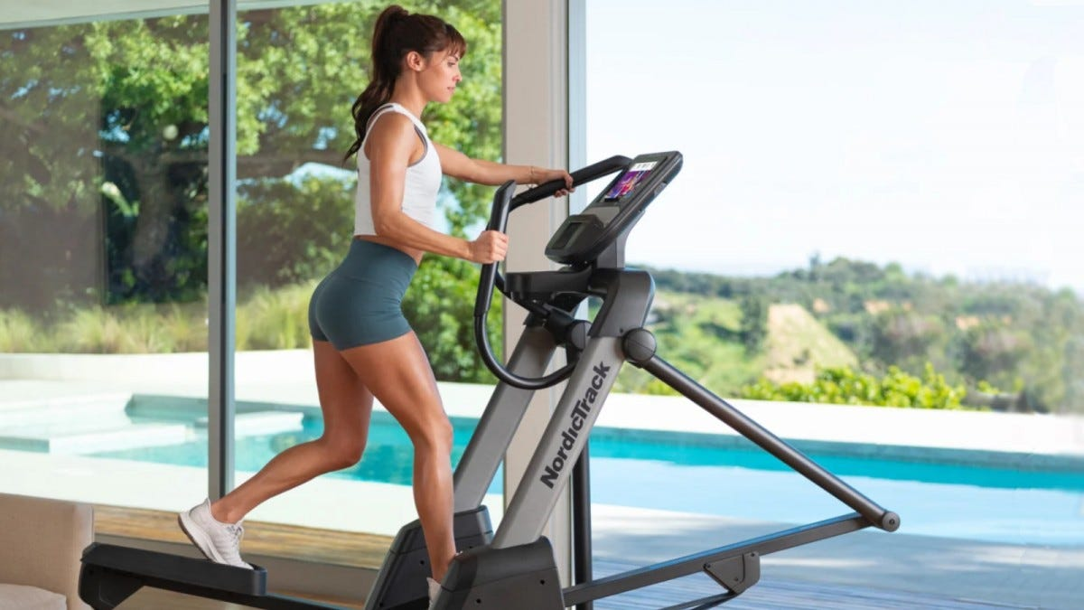 Woman uses Nordic Elliptical trainer