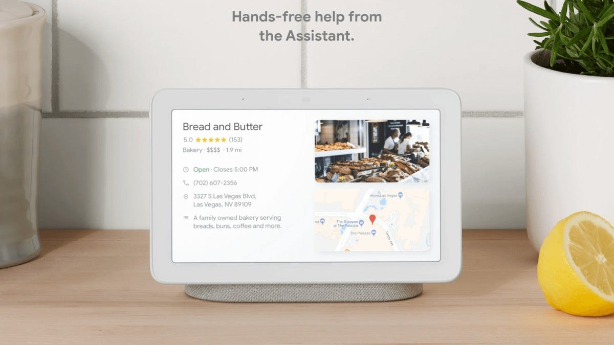 A Nest Hub display with a receipt for bread in a kitchen.
