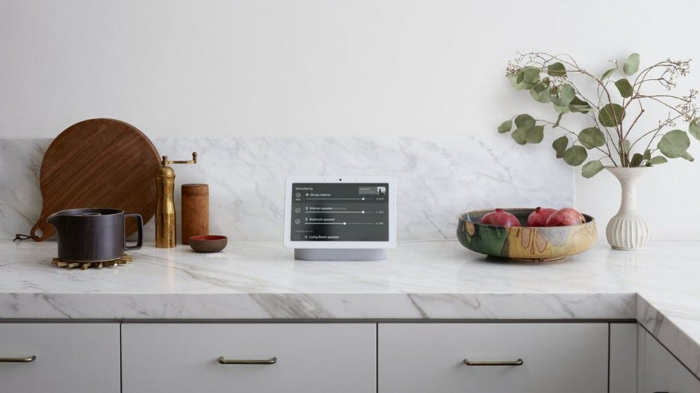 A Google Nest Hub Max on a kitchen counter.