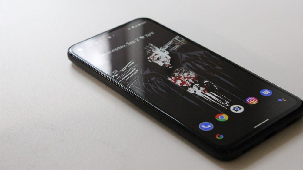 The Pixel 4a with the display on, lying on a white background