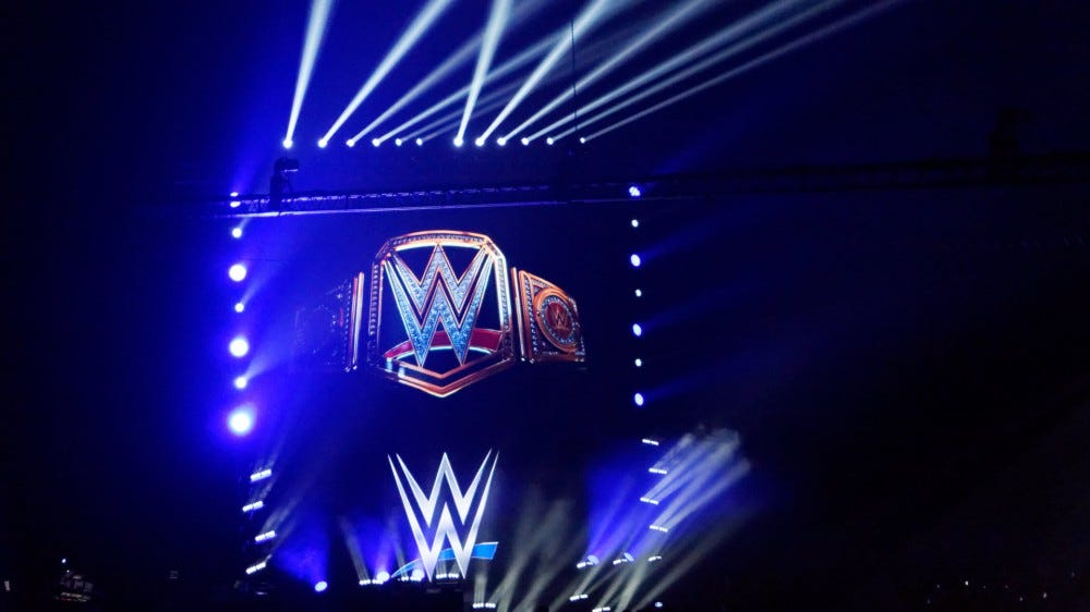 A WWE Stage with Lights shining everywhere