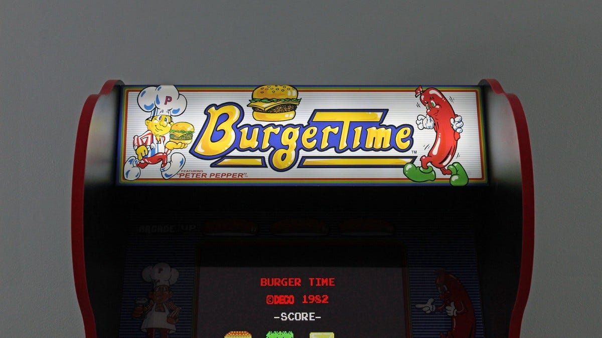 A close up the Burger Time marquee glowing in the dark.