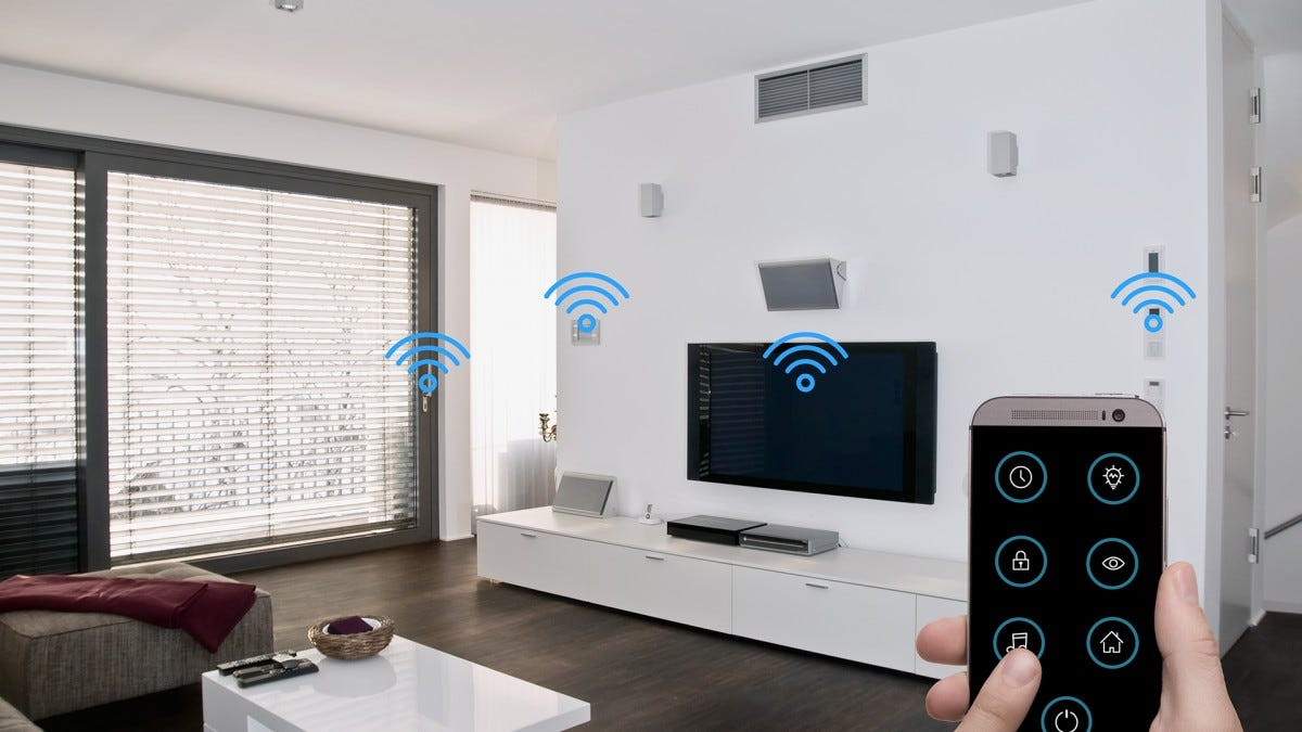 A man controls a smarthome using his phone. He's got a lot of connected devices, maybe he should get a universal remote.