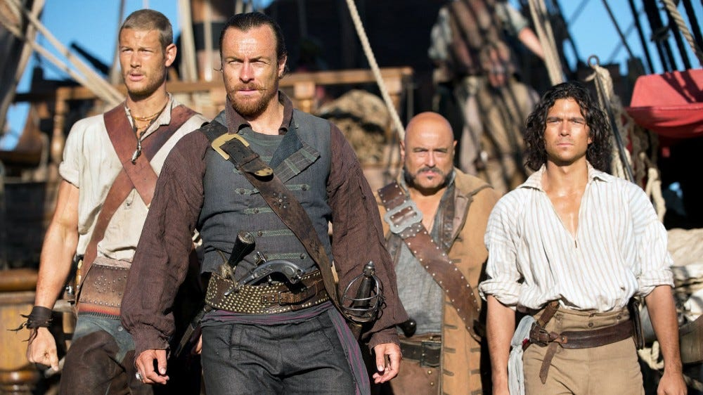 Captain Flint, Billy Bones, John Silver, and Gates in Black Sails