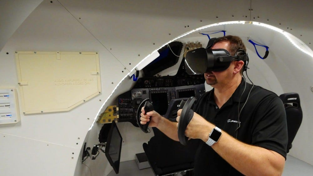 A photo of a man using a Varjo VR-2 headset to train for space travel.