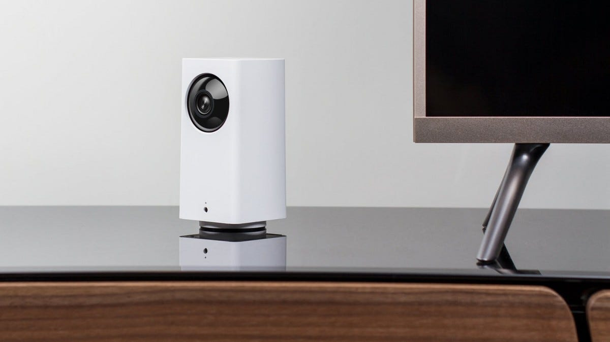 A Wyze Cam Pan on a TV stand