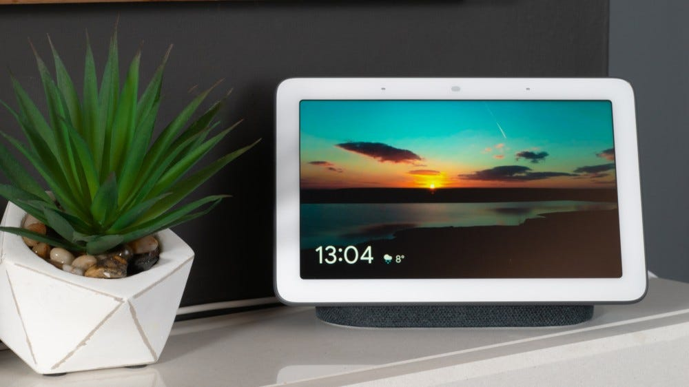 Google Nest Hub on a table with a succulent