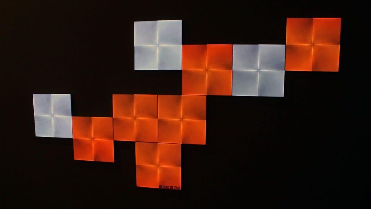 Nine Canvas panels showing shades of orange and white.