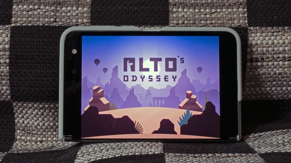 A Surface Duo with just a single screen showing, and Alto's Oddessey playing.